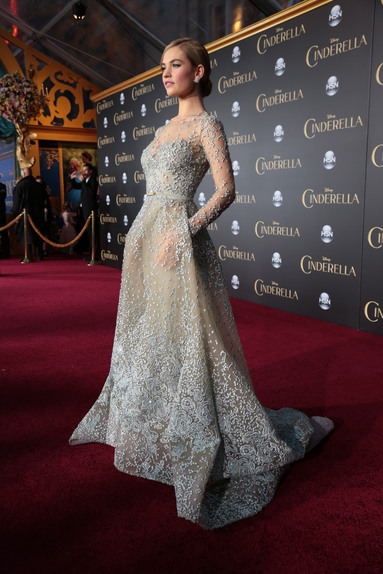 """Lily James arrives as Disney Pictures presents the world premiere of """"Cinderella"""" at the El Capitan Theatre in Los Angeles, California on Sunday, March 1, 2015. .(Photo: Alex J. Berliner/ ABImages)"""